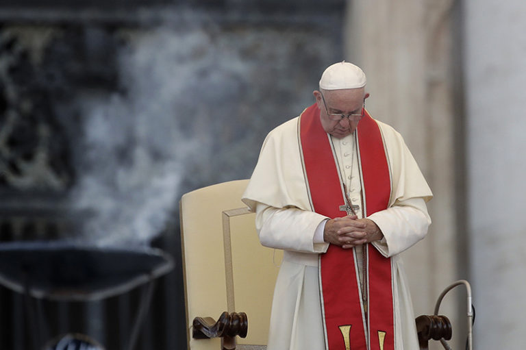 "FILE - In this file photo dated Tuesday, July 31, 2018, Pope Francis prays during an audience in St. Peter's square at the Vatican.  The Vatican said Thursday Aug. 2, 2018, that Pope Francis has changed church teaching about the death penalty, saying it can never be sanctioned because it ""attacks"" the inherent dignity of all humans. (AP Photo/Alessandra Tarantino, FILE)"
